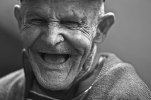 Joyful old man laughing