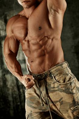 Muscular Guy Flexing in Army Shorts